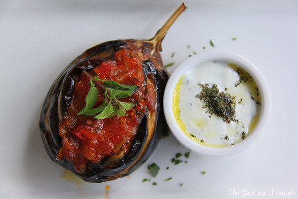 Imam bayildi: pan fried eggplant stuffed with capsicum, spring garlic and sauteed onion