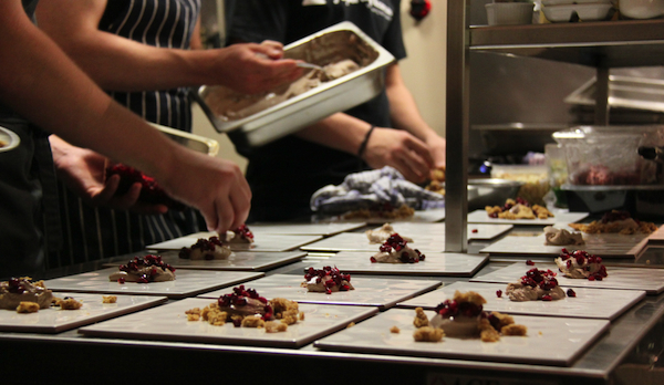 Wasted popup, Plating the final dish of the night - dessert on tiles.
