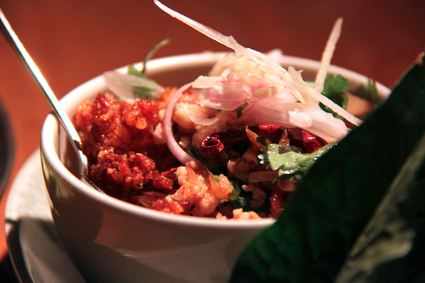 Nahm Bangkok, spicy pork with mint, peanuts, crunchy rice on betel leaf