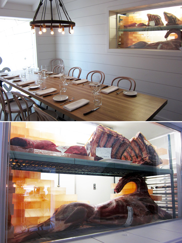 The private dining room, complete with a window into the showcased meat larder