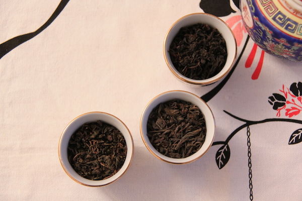 A selection of red tea and black Chinese teas, oolong; pu-erh; and ti kuan yin (metal buddha)