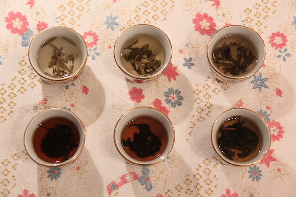 continuum of colour and flavour intensity from white to black Chinese tea (clockwise from top left): Souchong (white); lung ching (green); jasmine (green); ti kuan yin (red); pu-erh (red); oolong (black)