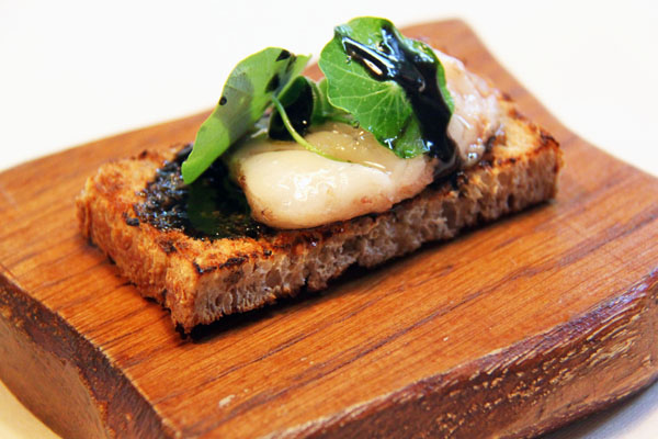 Grilled toast of bone marrow with herbs and horseradish ash, Mugaritz