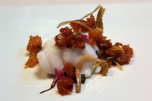 Slices of monkfish cooked with the steam of its own bones. Crispy stew of roasted rinds and lillies, Mugaritz